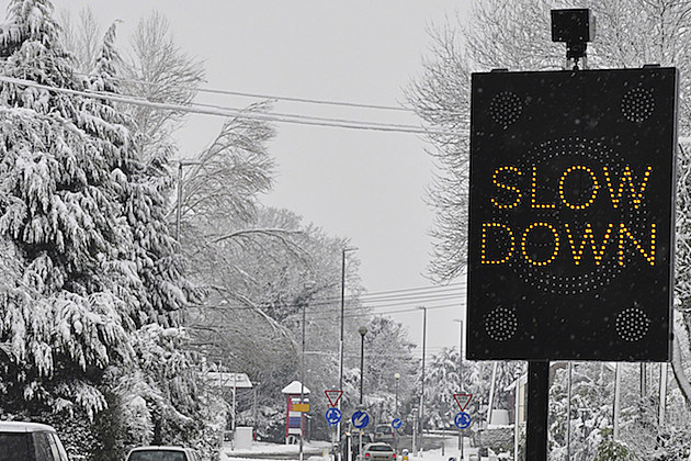 Slow+Down+Sign+-+Credit-+iStock+-+118862846